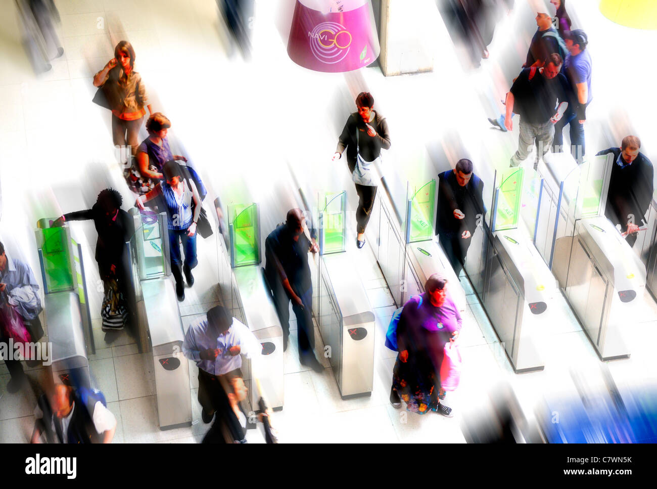 Paris, France. People passing through gates in the Paris Metro - heavily manipulated / motion blur - Stock Image