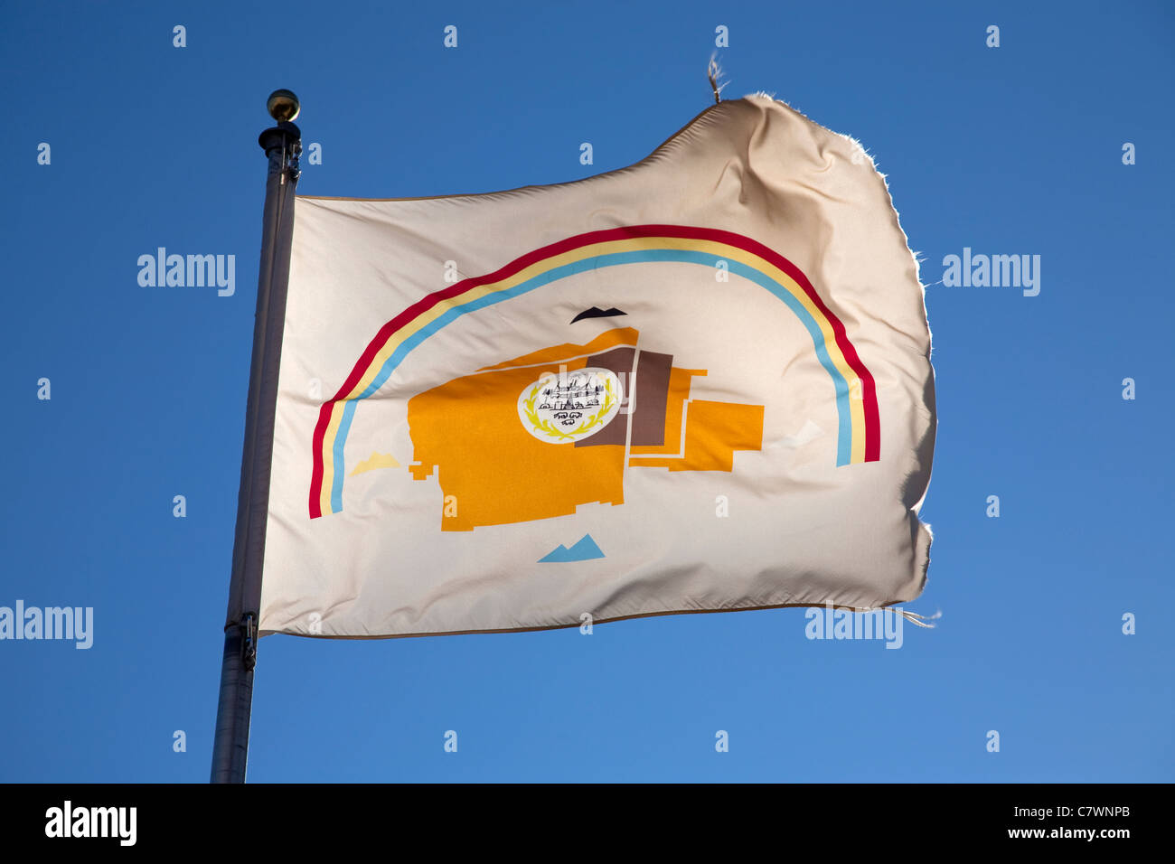 flag of the navajo nation native american indians against a blue summer sky at their headquarters at Window Rock - Stock Image