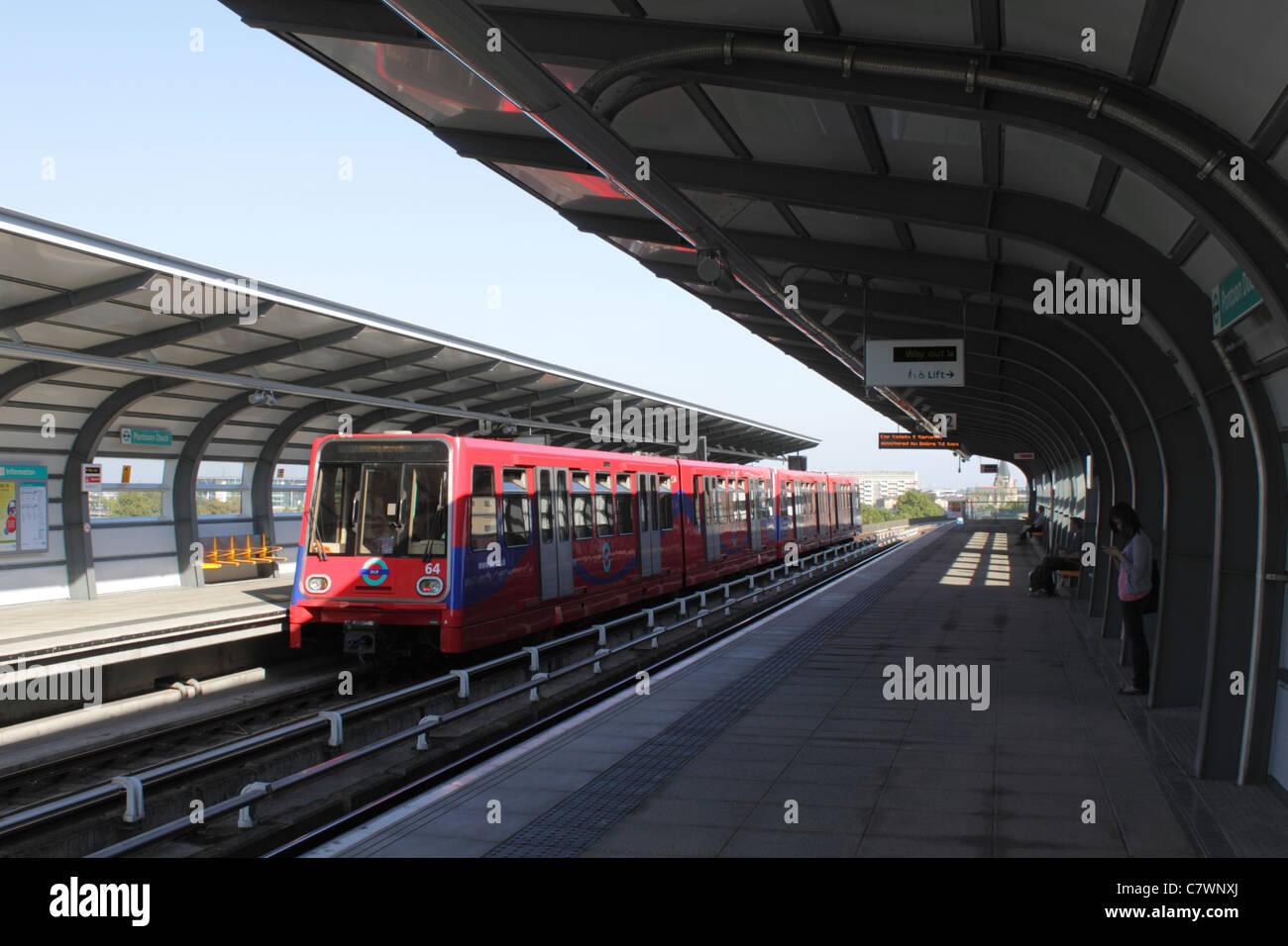 Docklands Light Railway train at Pontoon Dock Station London - Stock Image
