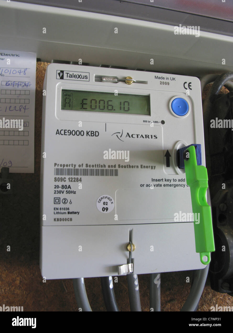 quantum key prepayment electric meter, paying for electricity as you use it - Stock Image