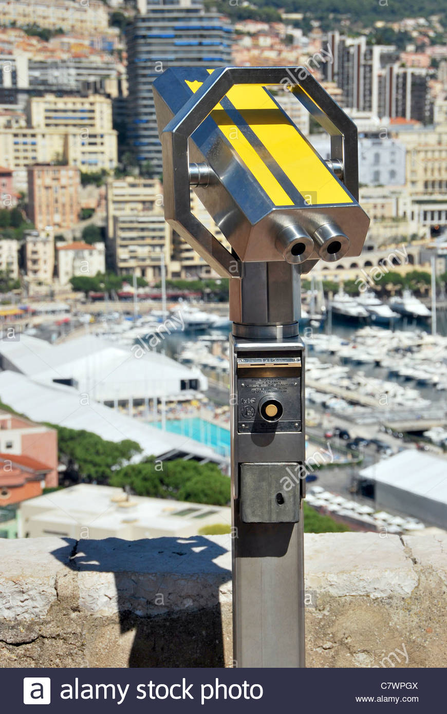 Touristic binocular in yellow. Optical instrument to magnify panoramic views - Stock Image