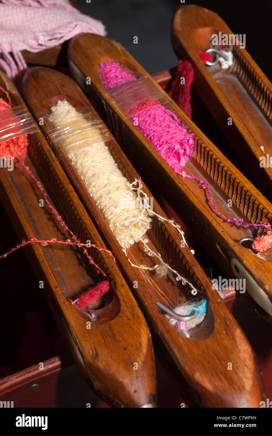 Ireland, Co Wicklow, Avoca Handweavers Mill, coloured weft threads in shuttle for fly loom weaving - Stock Image