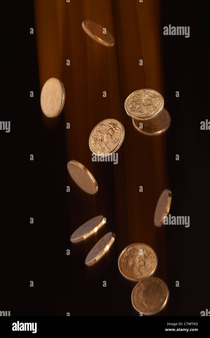 Australian dollar coins falling Stock Photo