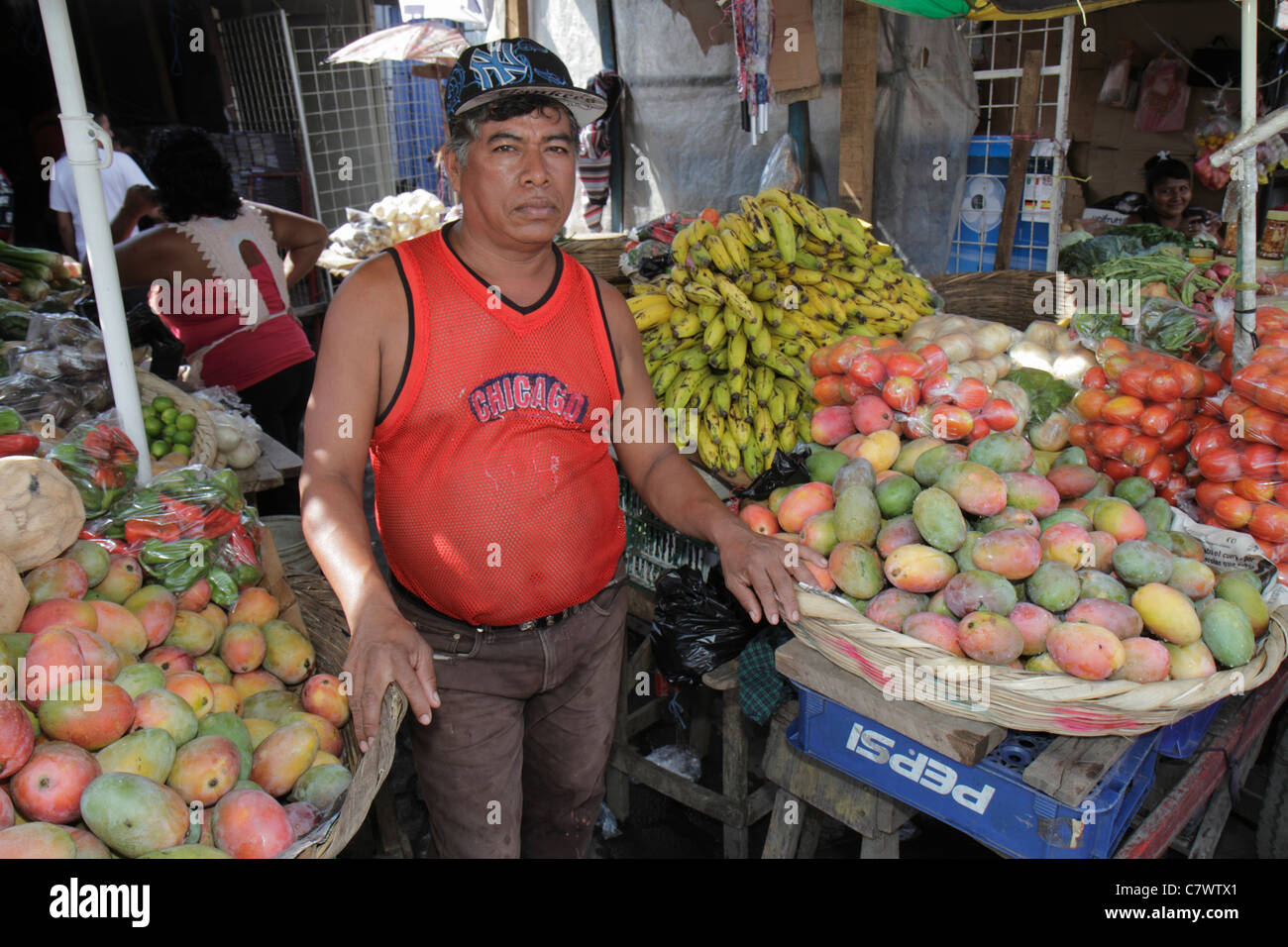 Managua Nicaragua Mercado Oriental flea market marketplace shopping produce stand vegetables fruit vendor merchant - Stock Image