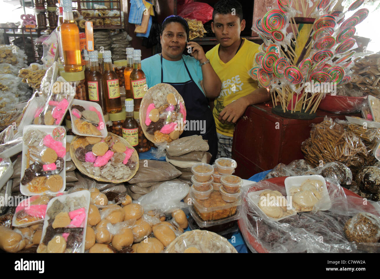 Managua Nicaragua Mercado Roberto Huembes market shopping marketplace baked goods family business owner vendor stall - Stock Image