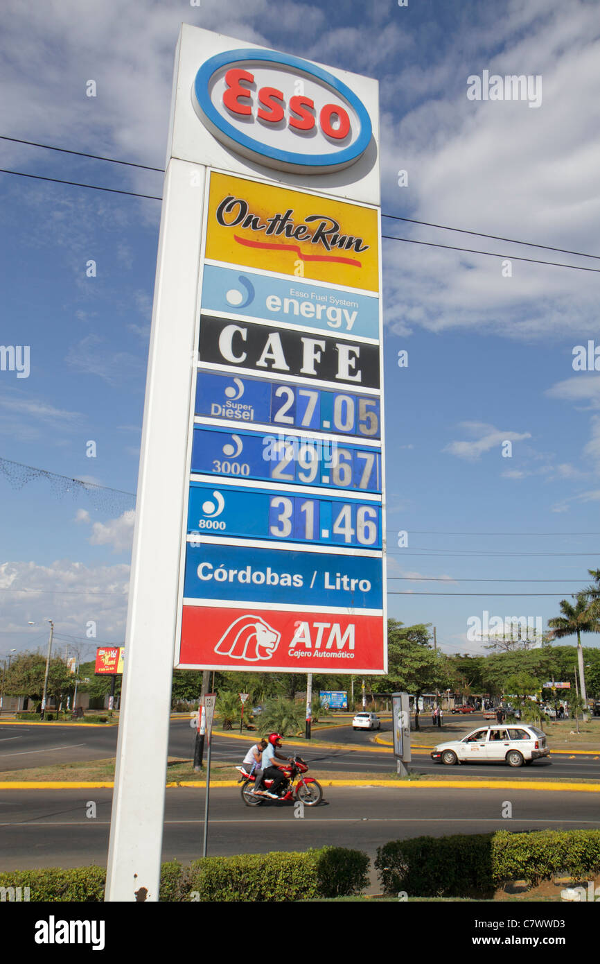 Managua Nicaragua Calle Colon street scene Esso business trade name Exxon Mobil multinational company petrol filling - Stock Image