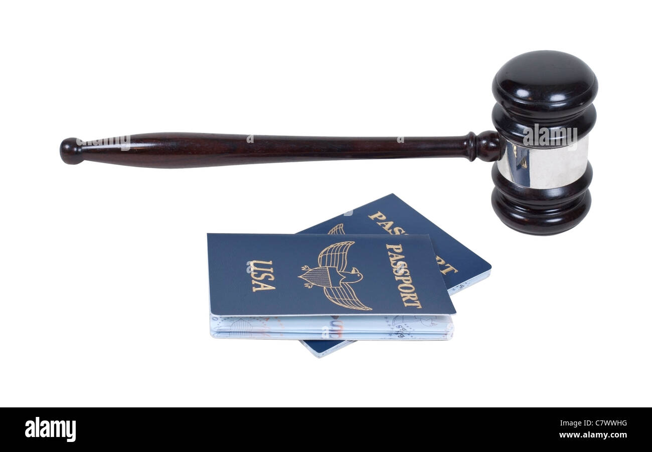 A ceremonial wooden gavel with a couple of passports - path included - Stock Image