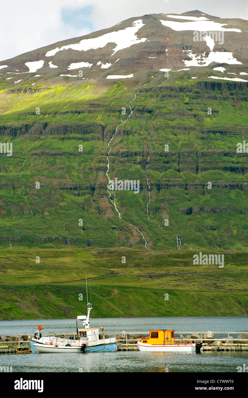 Fishing boats in the port of Seydisfjordur, a fjord in east Iceland. - Stock Image