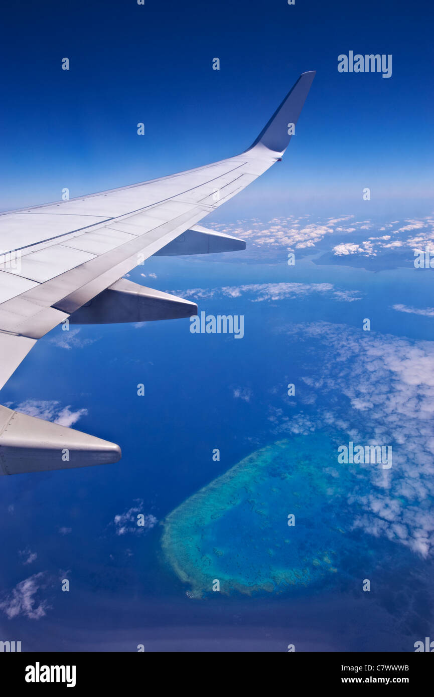 View from airline flying over the Great Barrier Reef Australia Stock Photo