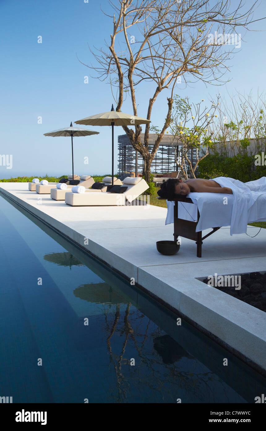 Woman enjoying massage at Alila Villas boutique hotel, Ulu Watu, Bali, Indonesia Stock Photo