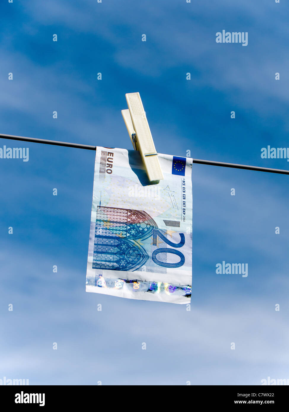 Concept representing money laundering Euro 20 note pegged on a washing line - Stock Image