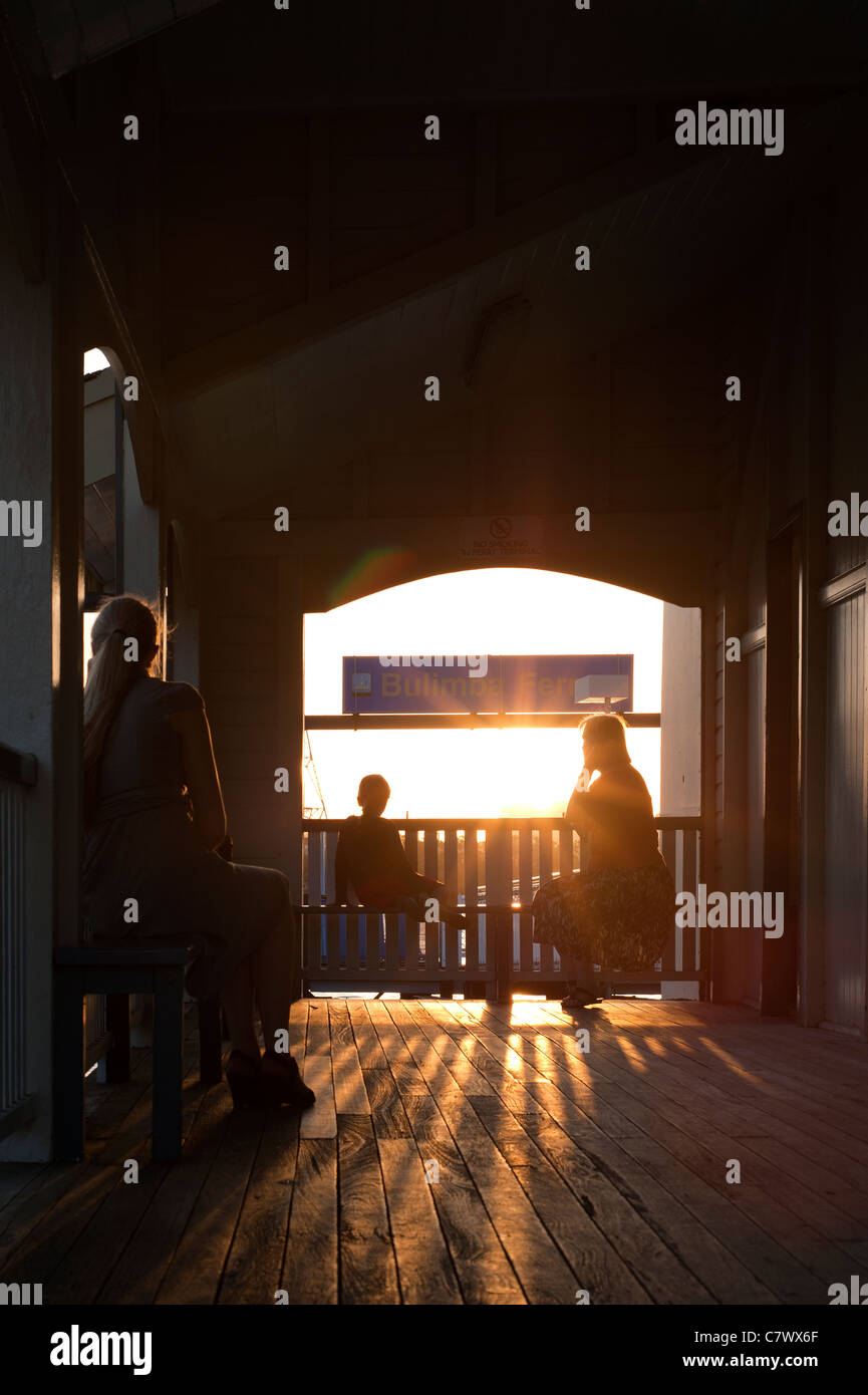 People waiting at Bulimba Ferry Terminal, Brisbane Australia - Stock Image