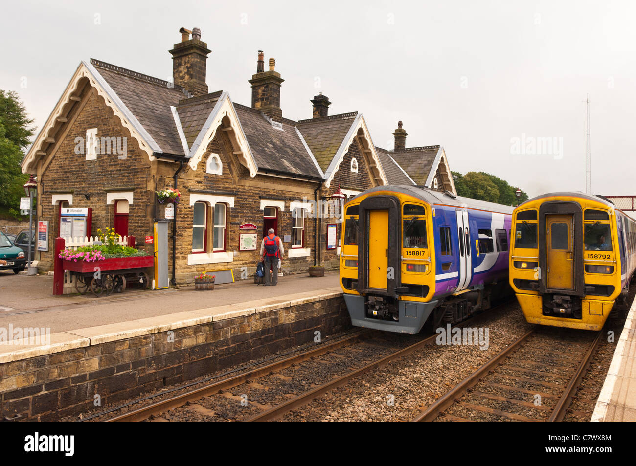 Two trains at the Railway Station at Settle in North Yorkshire , England , Britain , Uk - Stock Image