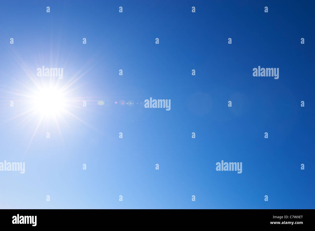 Sunny blue sky with sunburst - Stock Image