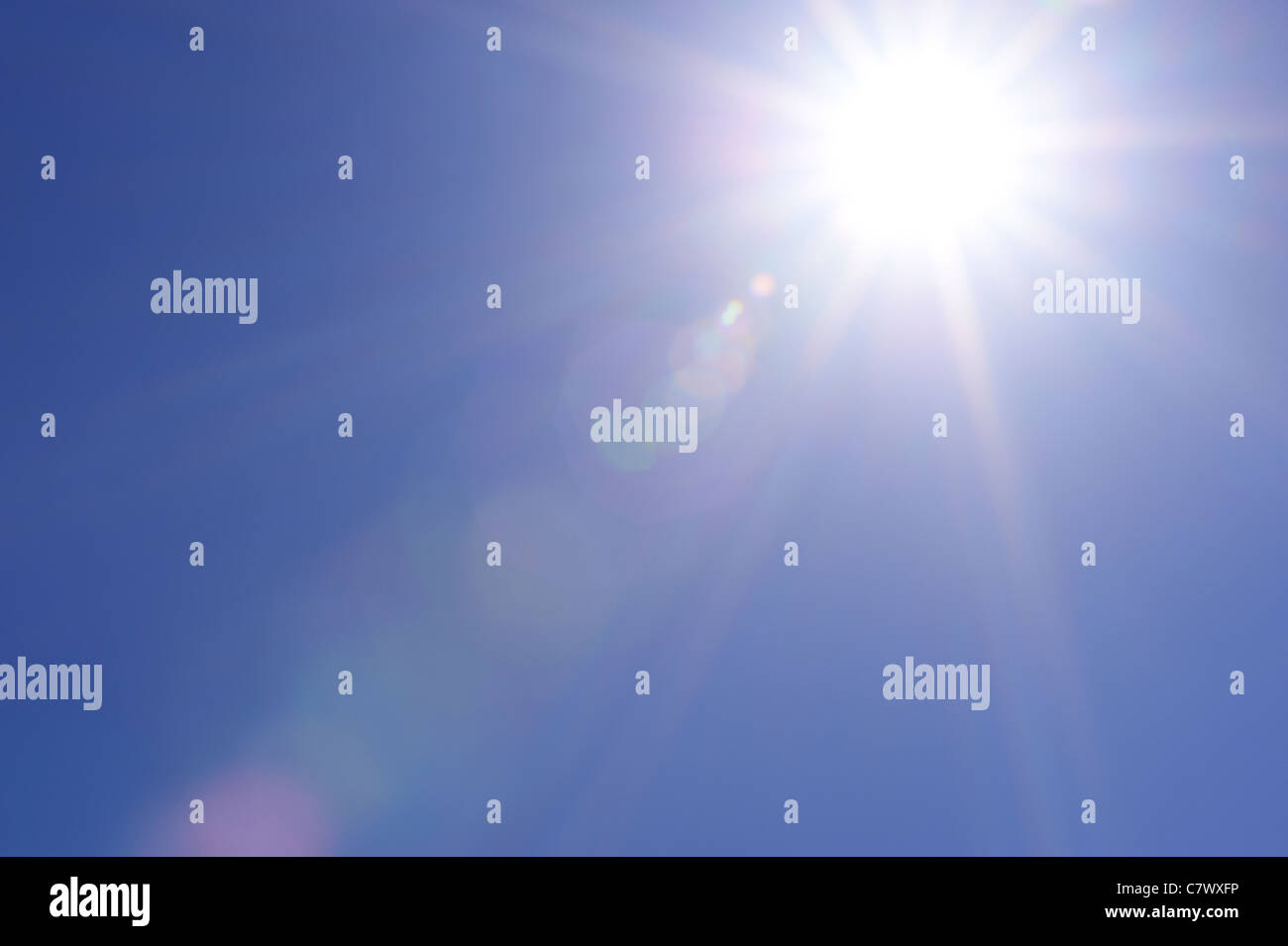 Clear blue sky and sunburst - Stock Image
