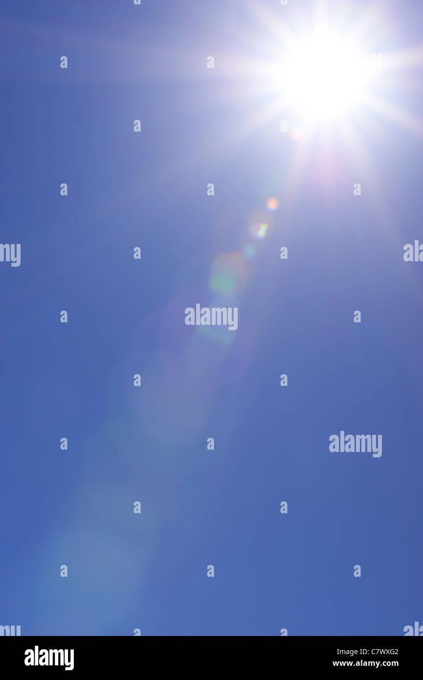 Clear blue sky and sunburst - Stock Image