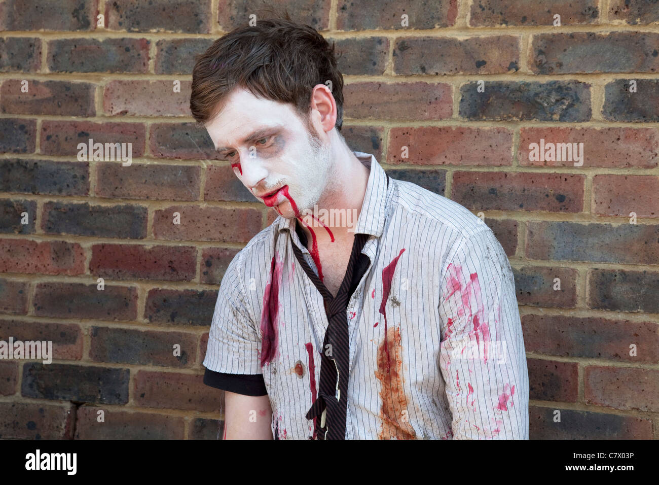 Stoke Newington Zombie protest. Demonstrating against the planned opening of a large Sainsbury's supermarket. - Stock Image