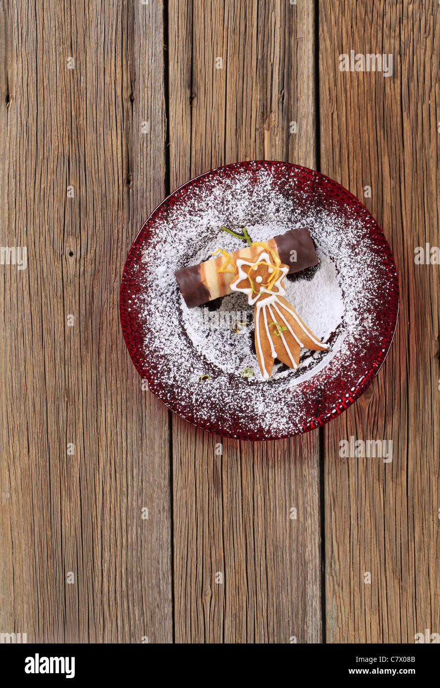 Chocolate dipped wafer cookie and gingerbread comet - Stock Image