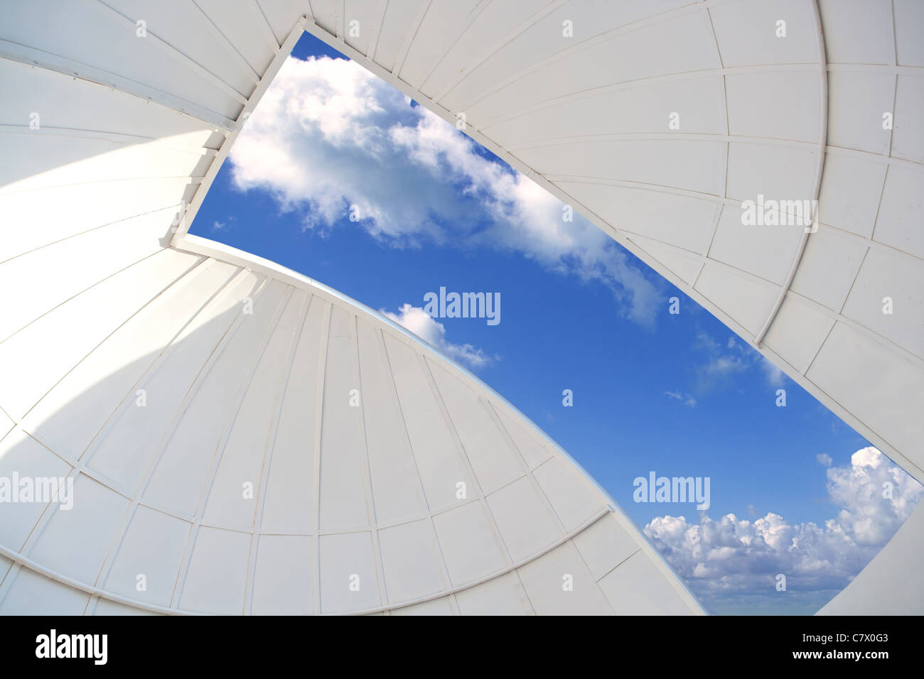 astronomical observatory indoor white dome blue sky window - Stock Image