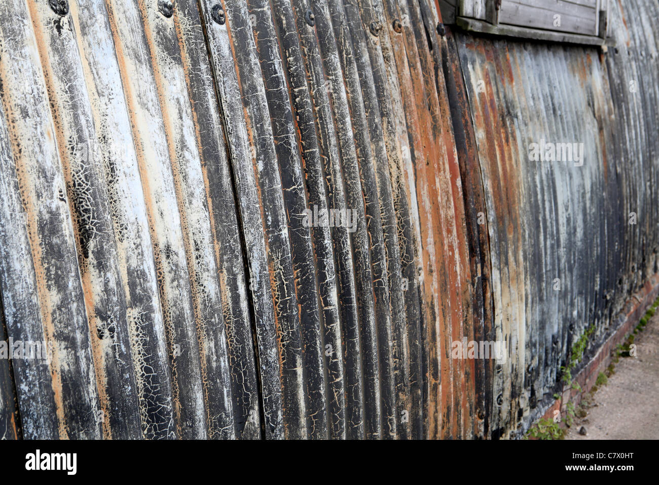 tin sheeting with faded paintwork - Stock Image