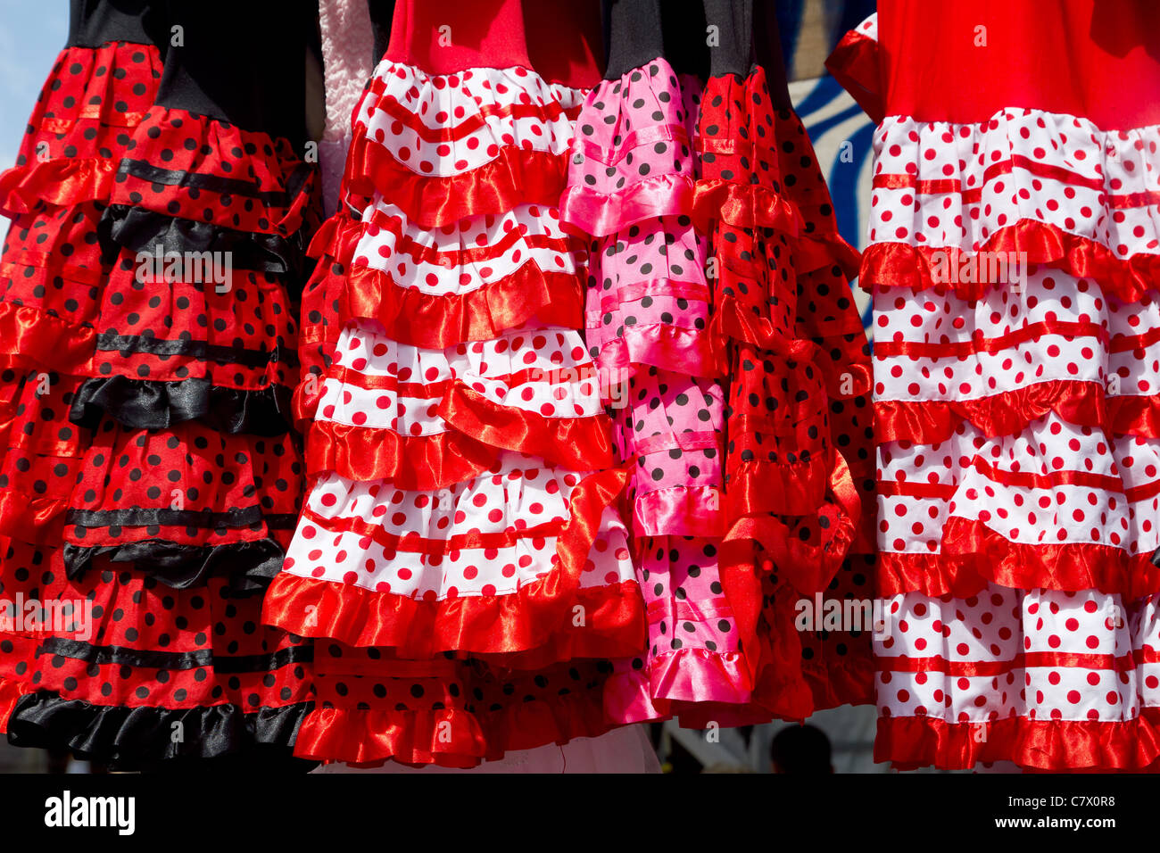 colorful red pink gipsy costumes of flamenco dancer in andalusian - Stock Image