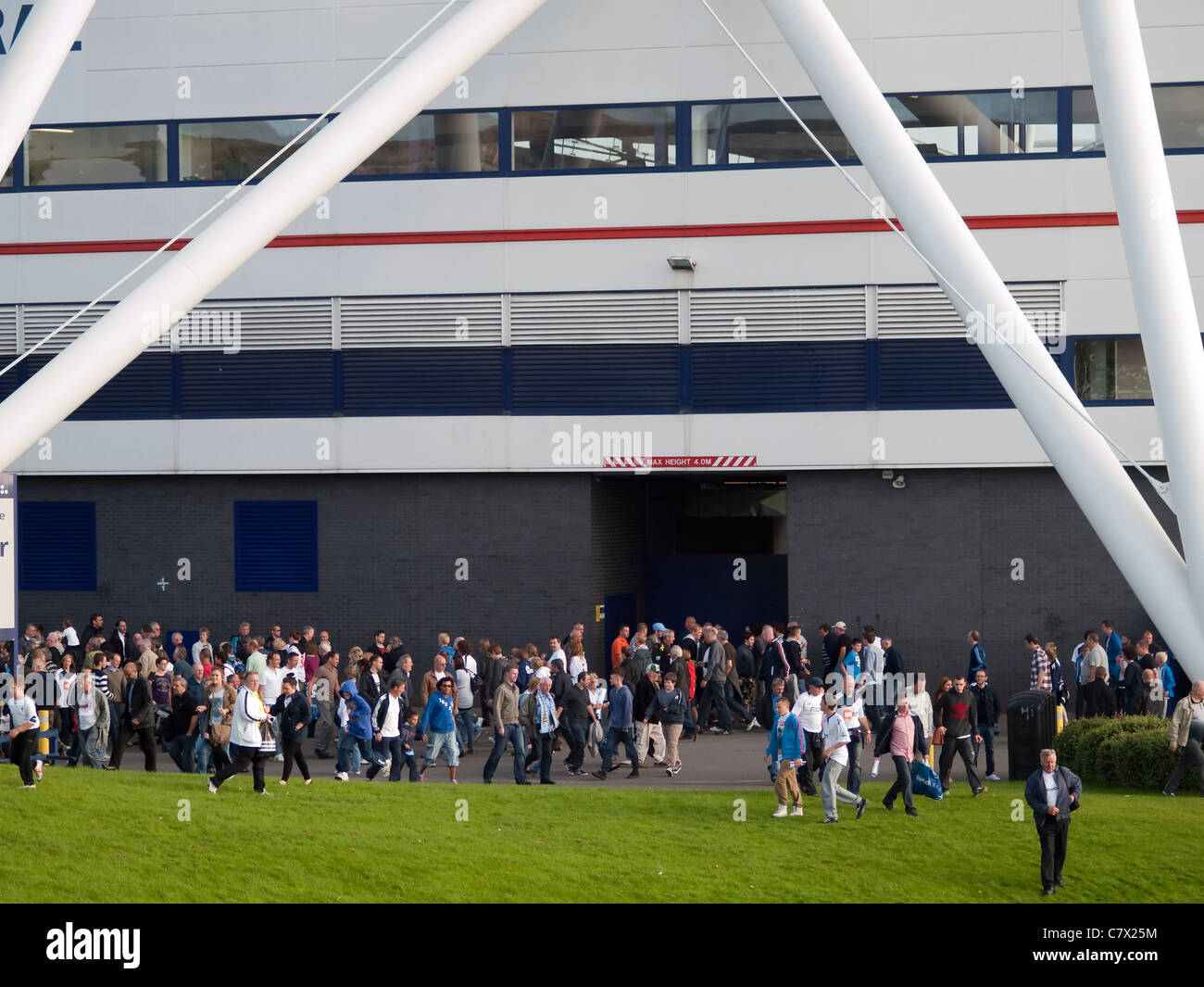 Fans leaving the Reebok Stadium, the home ground of Bolton Wanderers at the end of the game. - Stock Image