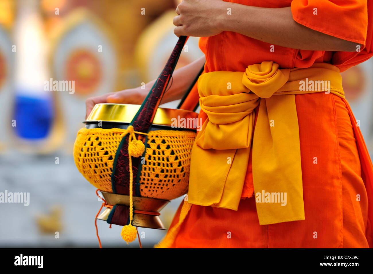 Buddhist monks walking with monk bowl to collect food in the morning. UNESCO listed world heritage city of Luang Stock Photo