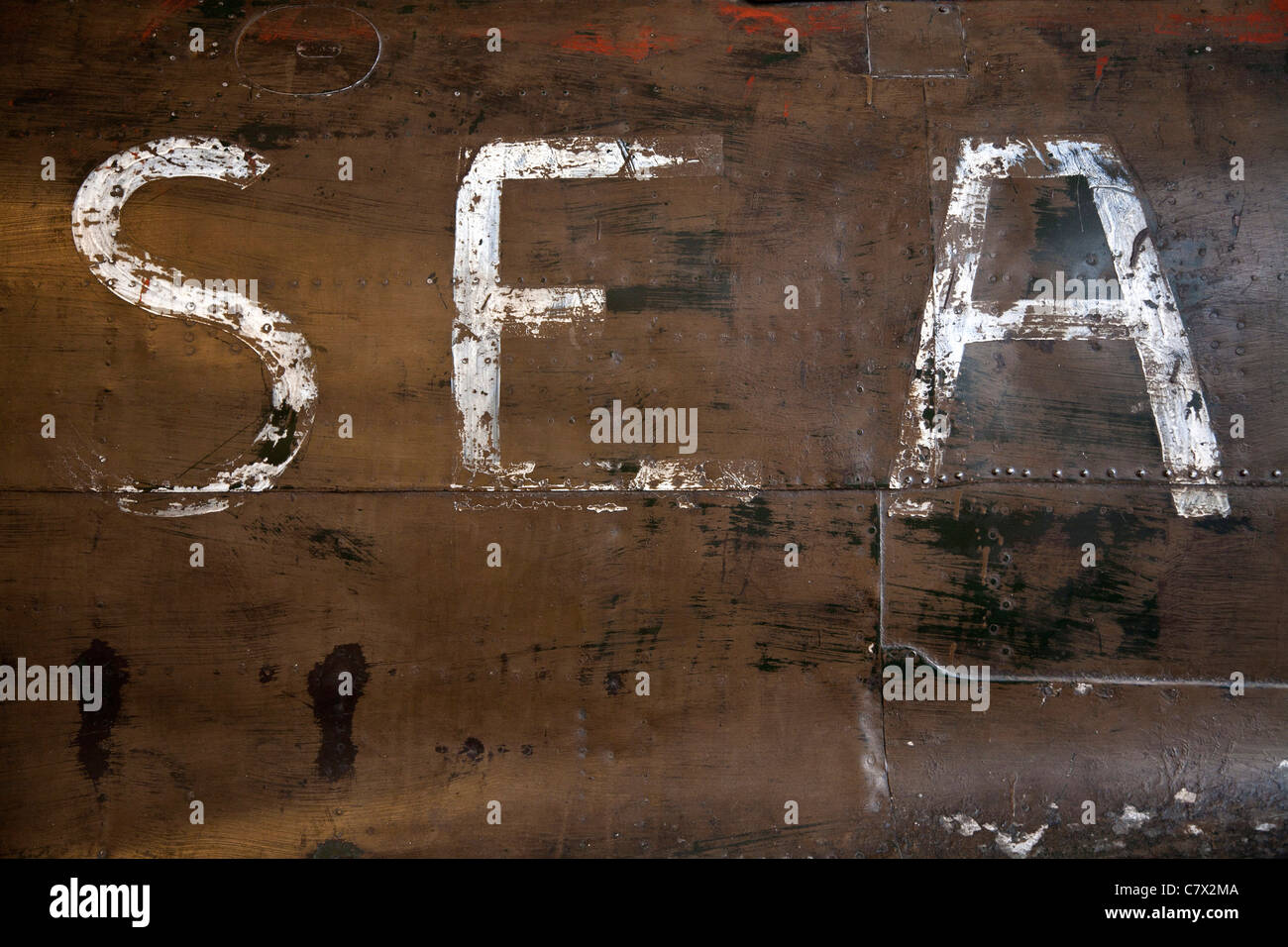 White letters S E A painted on the side of a Mitsubishi A6M Zero WW2 aircraft fuselage in the Imperial War Museum, - Stock Image