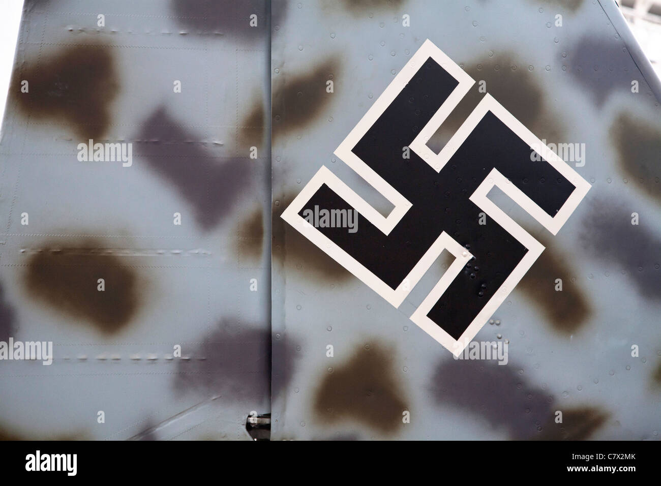 Nazi swastika and camouflage on the tail of a Focke-Wulf WW2 aircraft in the Imperial War Museum, London. - Stock Image