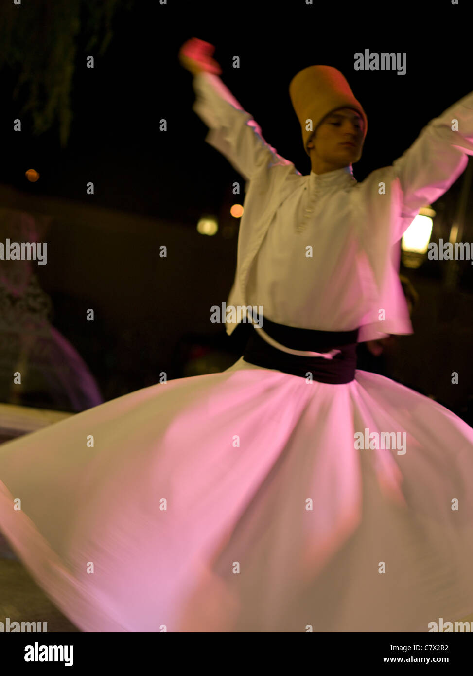 Sufi Whirling Dervish Dancer Istanbul, Turkey. Wearing sikke hat Stock Photo