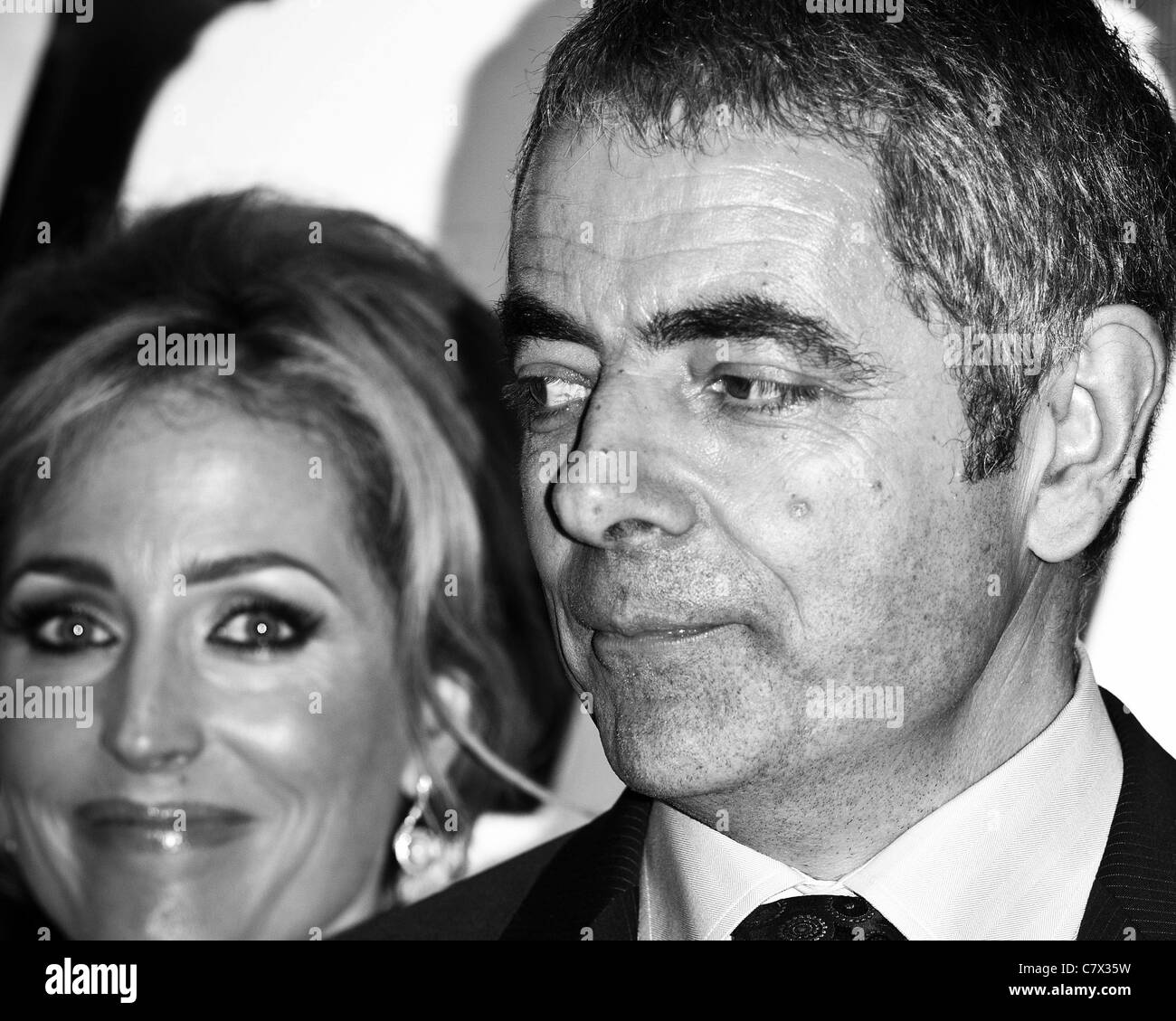 Rowan Atkinson and Gillian Anderson attends the UK Premiere of Johnny English Reborn at The Empire, Leicester Square, - Stock Image