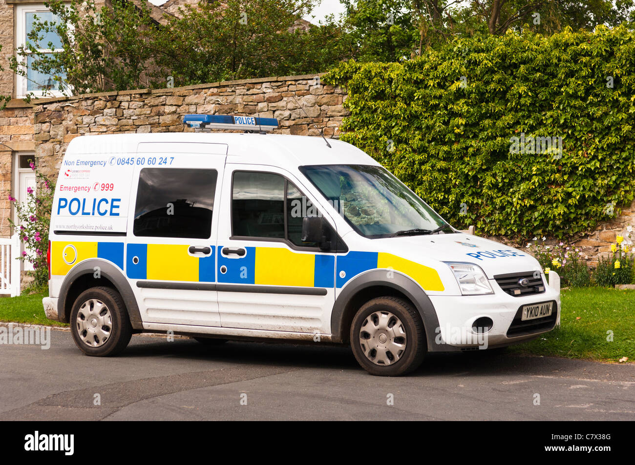 A Police van in the village of Reeth in Swaledale in North Yorkshire , England , Britain , Uk - Stock Image