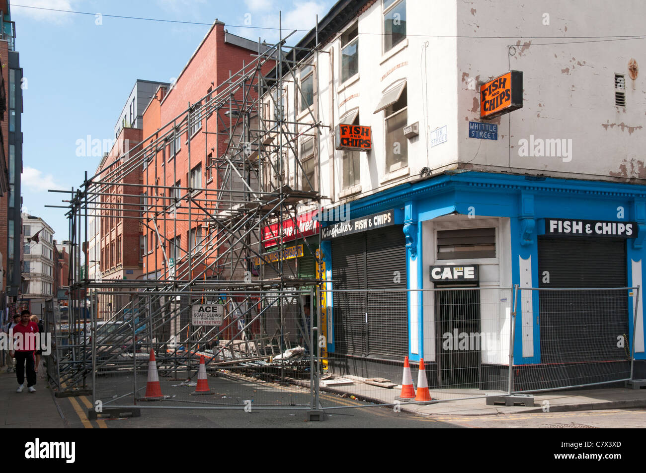 Scaffolding blocking a street to secure an unsafe building.  Tib Street, Northern Quarter, Manchester, England, Stock Photo