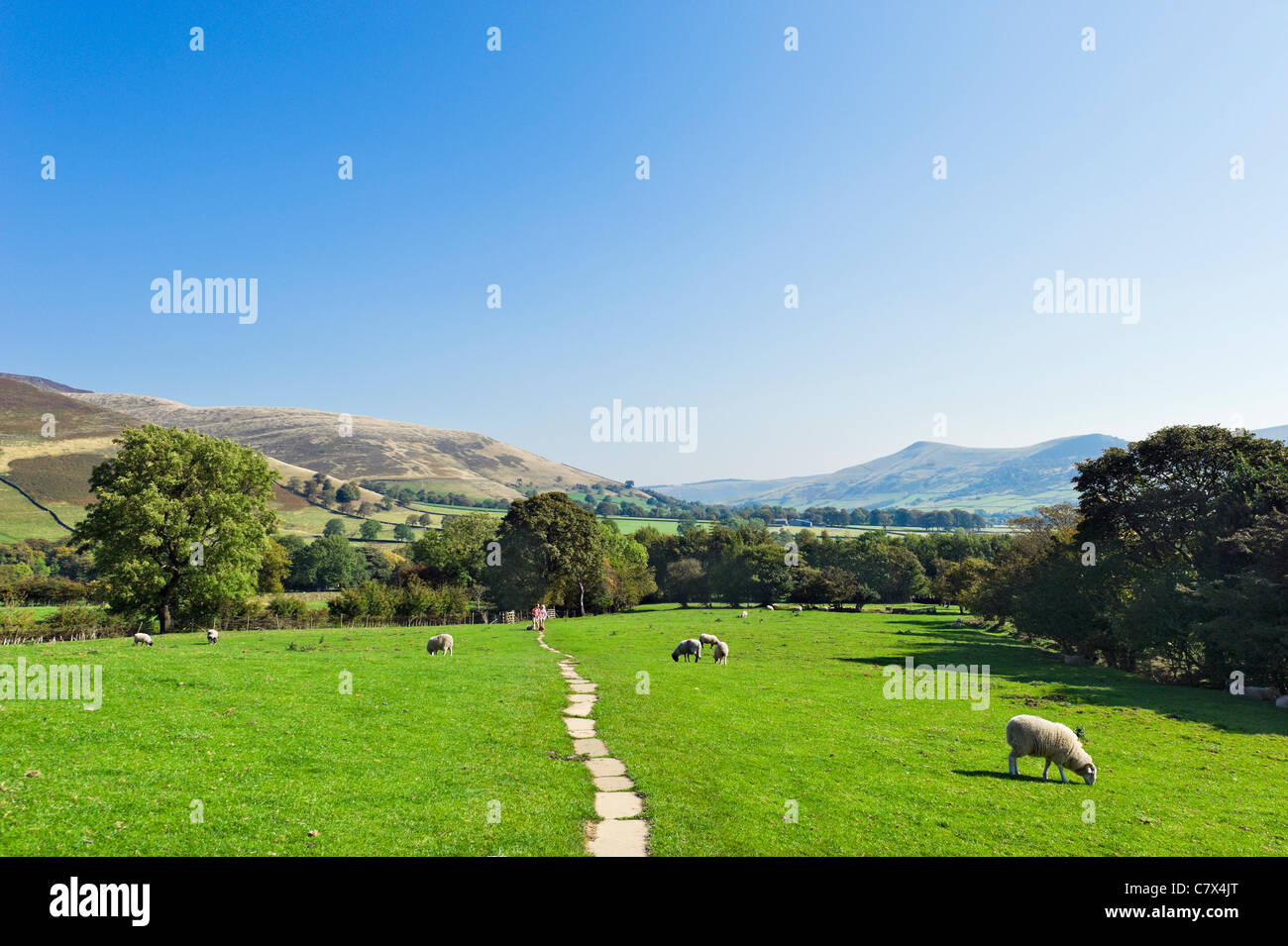 Walkers on The Pennine Way near its start in Edale looking towards the village, Peak District National Park, Derbyshire, - Stock Image