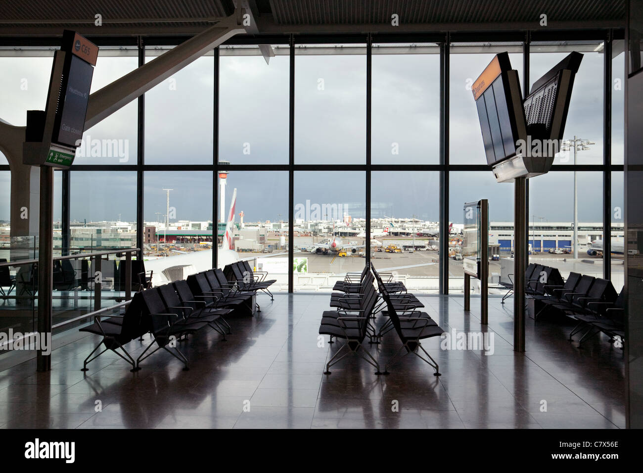 Empty departure Gate, terminal 5, Heathrow airport London UK - Stock Image