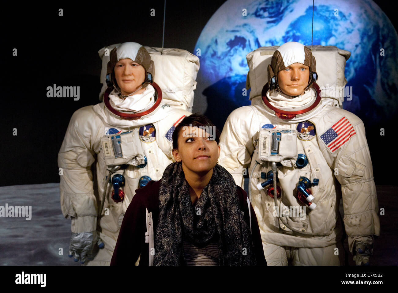 Tourist posing with waxworks of Neil Armstrong and Buzz Aldrin  at Madame Tussauds waxworks, Washington DC USA Stock Photo