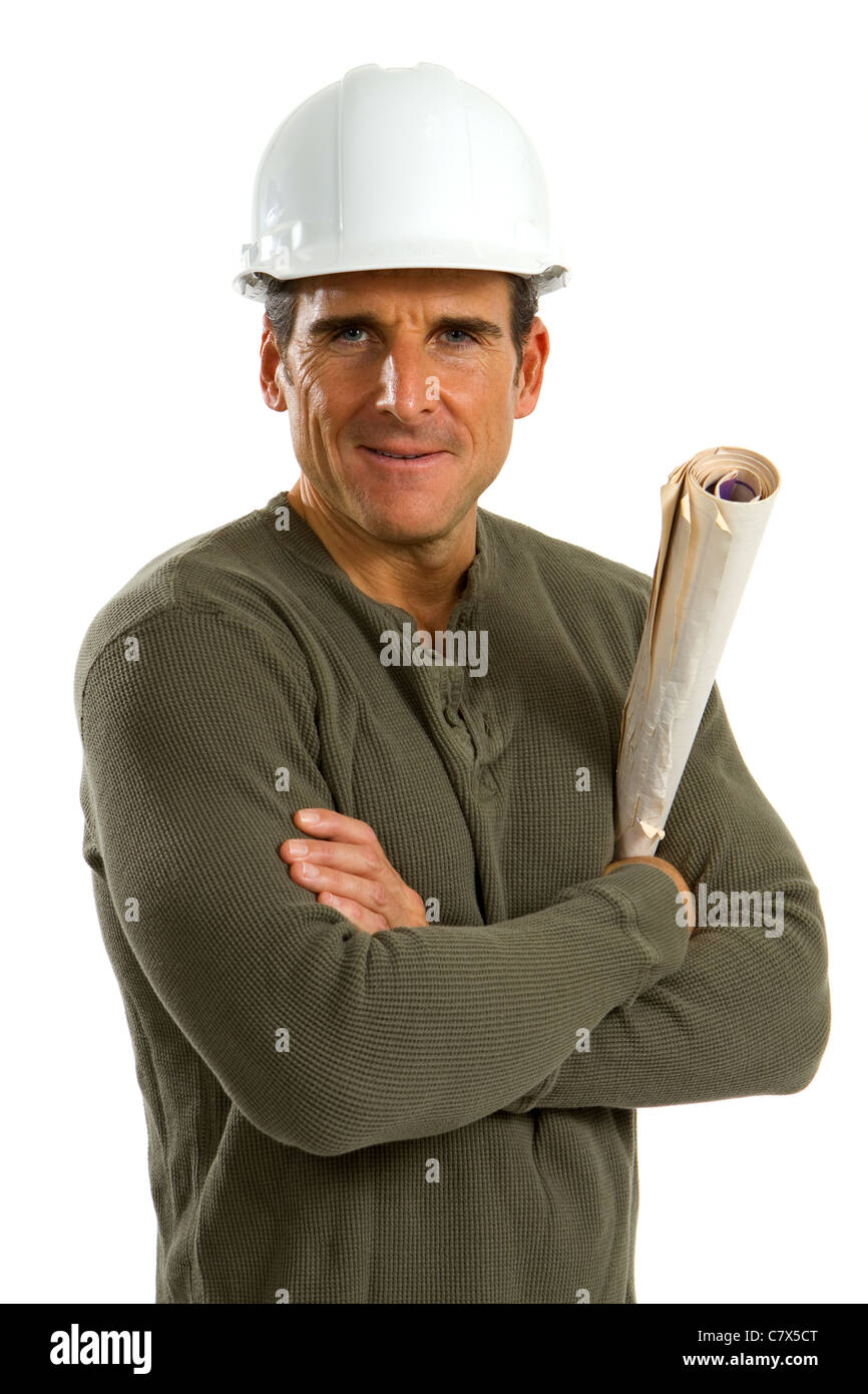 Boss of a construction company stands with crossed arms and holding blueprints against a white background. - Stock Image