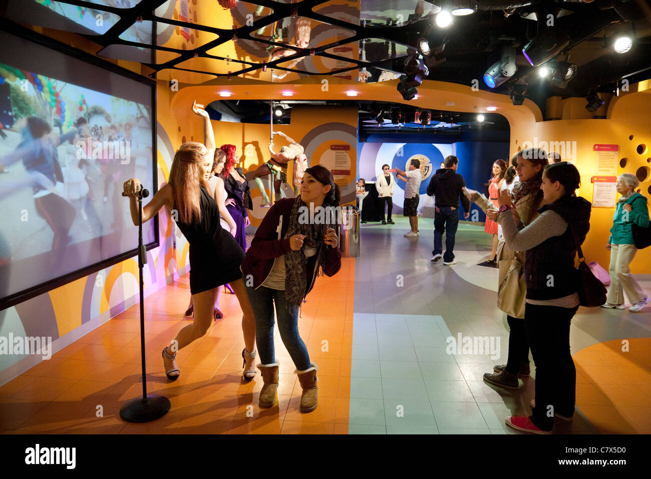 Tourists dancing with Beyonce at Madame Tussauds waxworks, Washington DC USA Stock Photo
