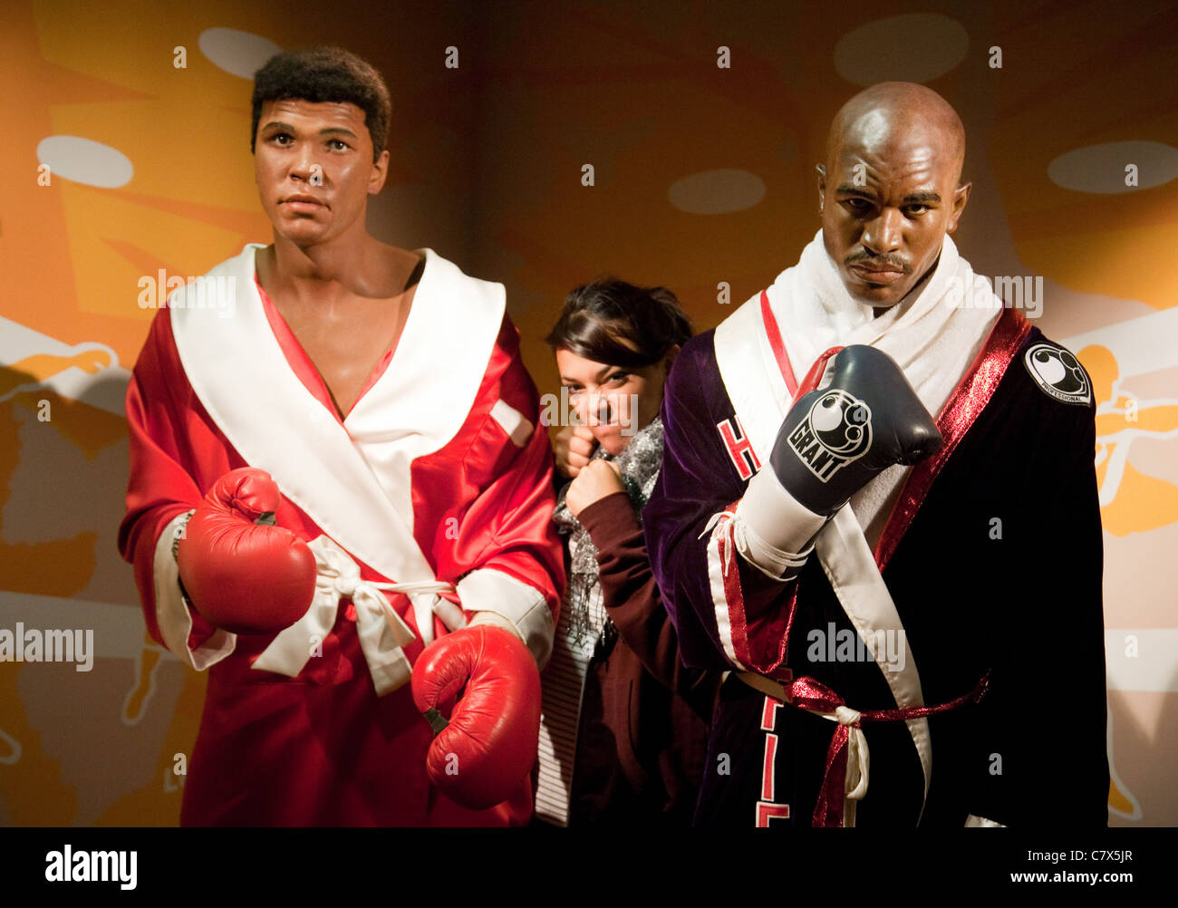 Young woman with waxworks of Muhammad  Ali and Evander Holyfield, Madame Tussauds Washington DC, USA - Stock Image