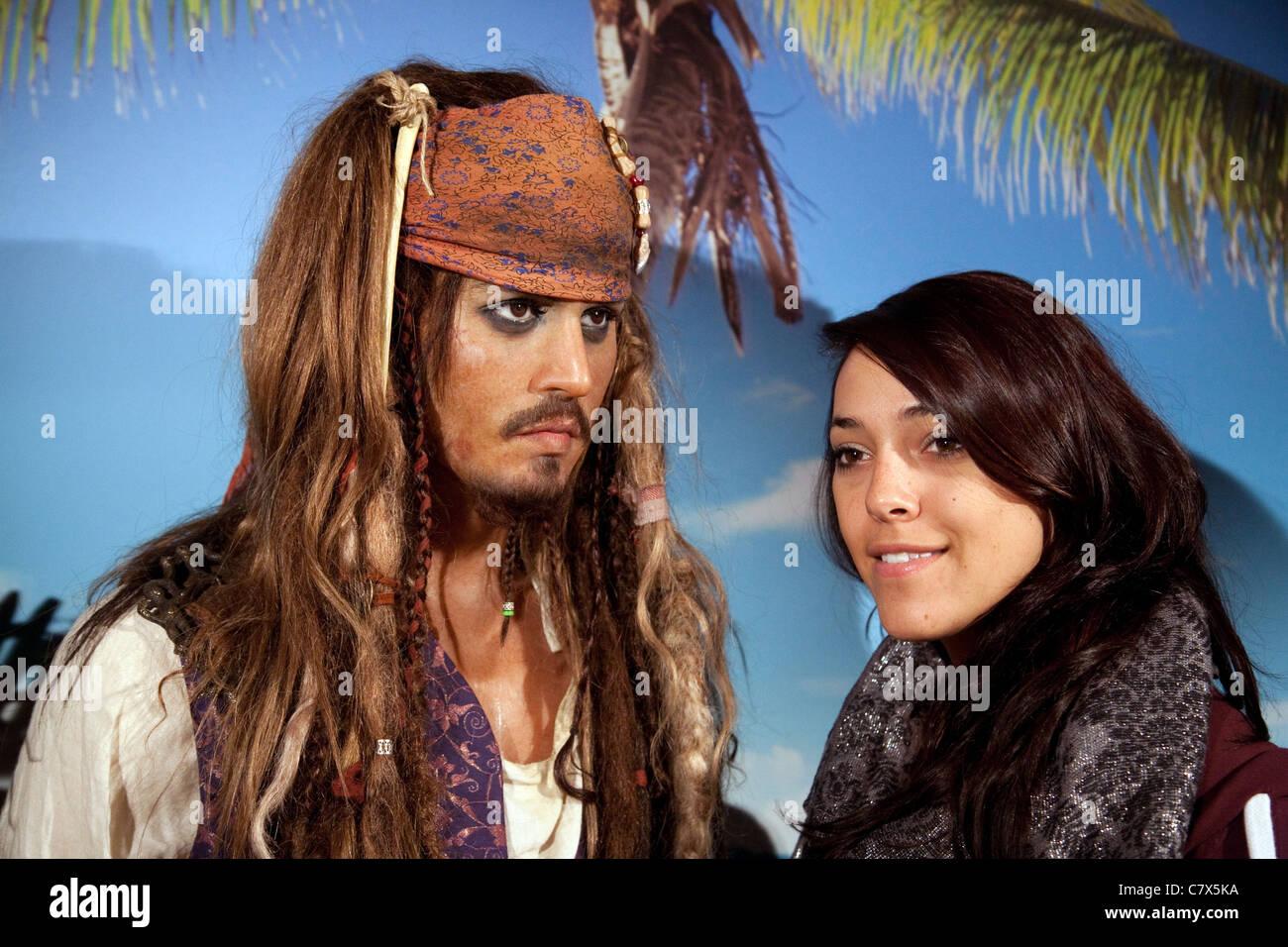 Teenage girl having her photo taken with waxwork of Johnny Depp as Captain Jack Sparrow, Madame Tussauds waxworks, Stock Photo