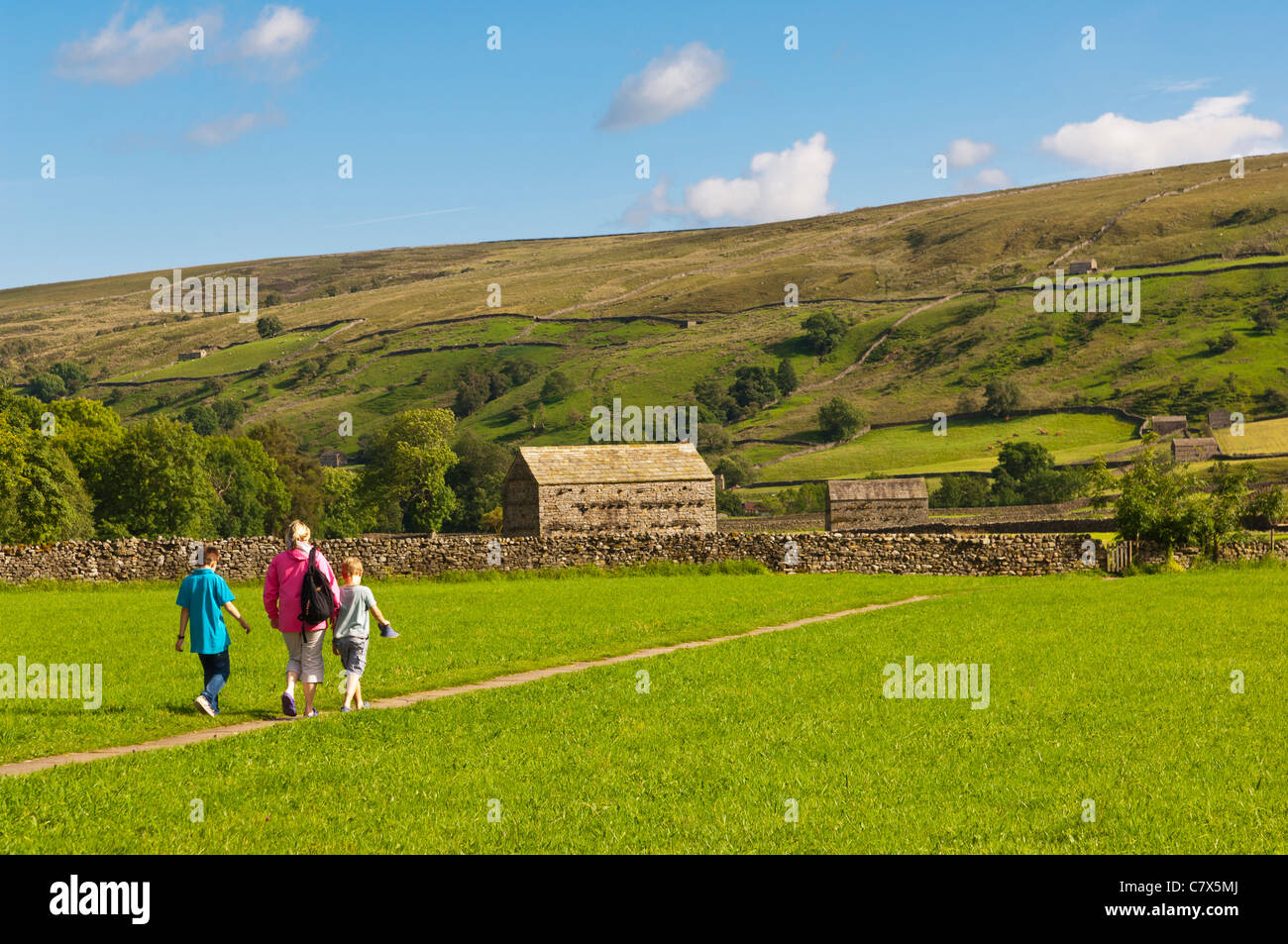 A family walking at Muker in Swaledale in North Yorkshire , England , Britain , Uk - Stock Image