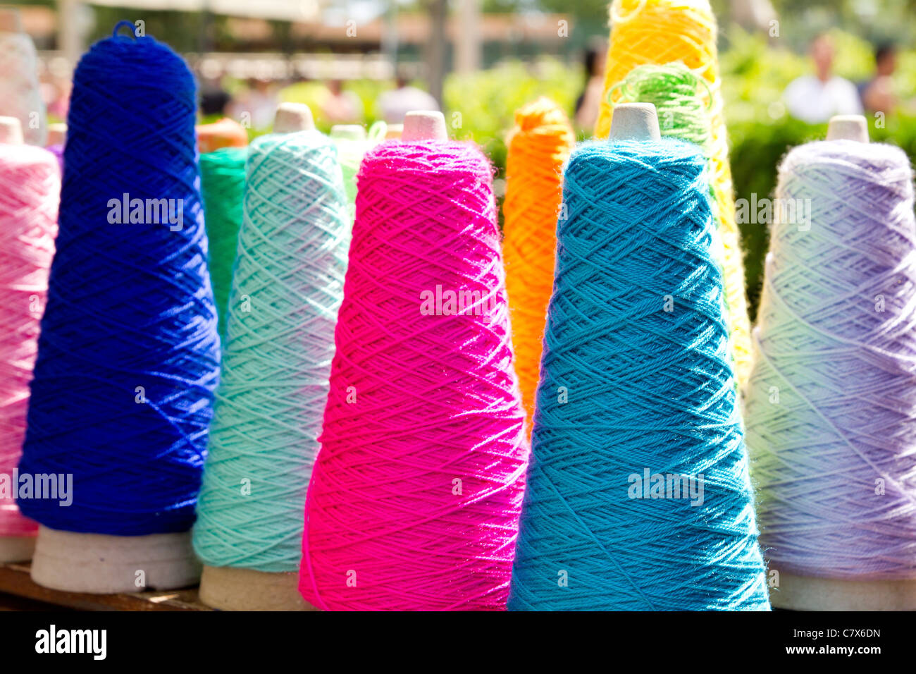 Embroidery colorful thread spool in rows - Stock Image
