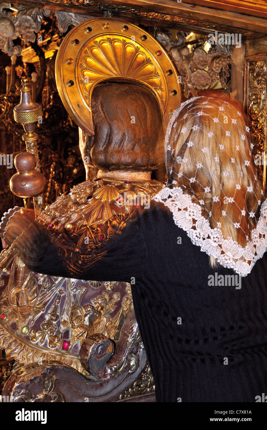 Spain, St. James Way: Traditional embrace of the Apostle Jakob in the main altar of the Cathedral of Santiago de Compostela Stock Photo