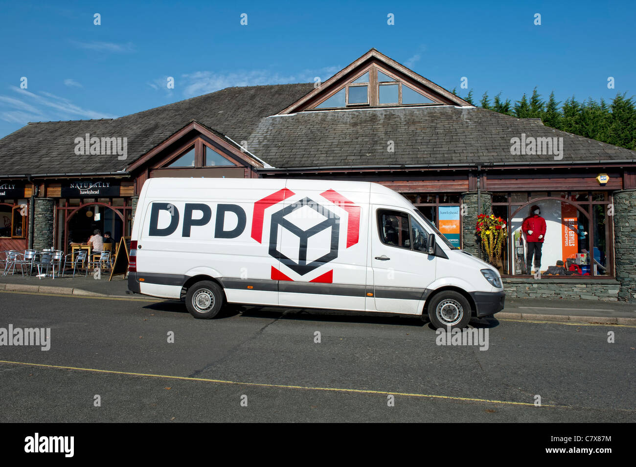 da15373cc8f222 DPD parcel delivery van outside a shop in the town of Hawkshead in Cumbria