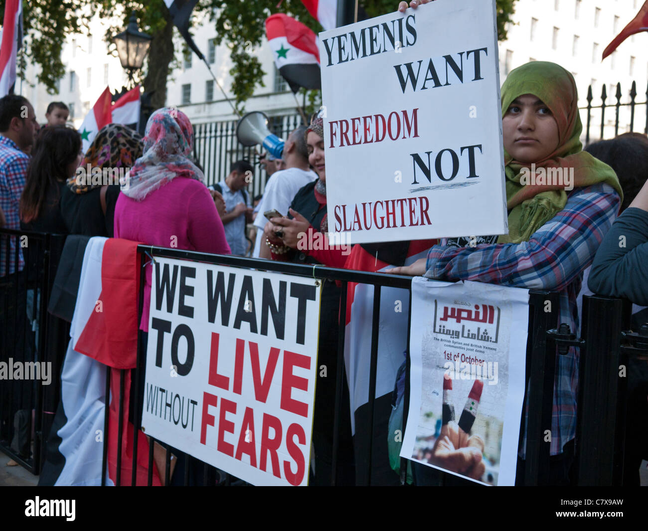 People demonstrating near Downing Street, in Whitehall London against the regime in Yemen and Syria - Stock Image