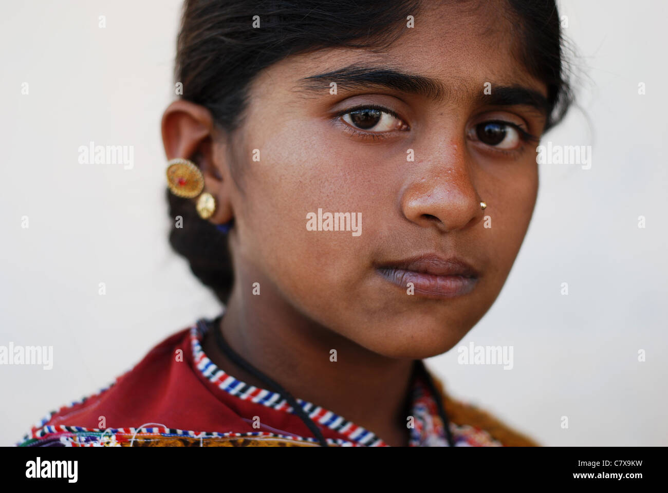 Portrait of a girl belonging to the Rabari caste, semi-nomadic shepherds living in western India. - Stock Image