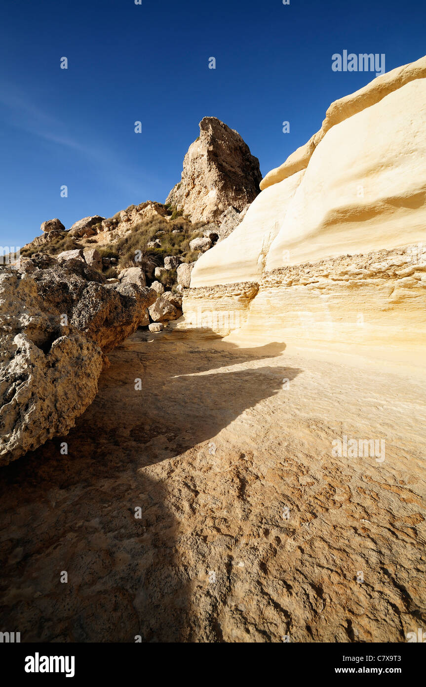 Rock formations and blue sky along Malta coastline Stock Photo
