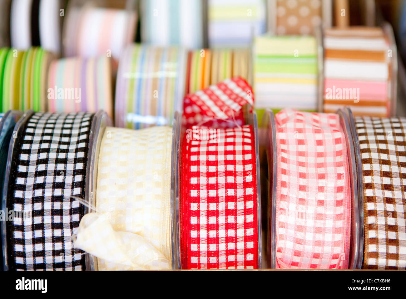fabric tapes reels in haberdashery of vichy squares - Stock Image