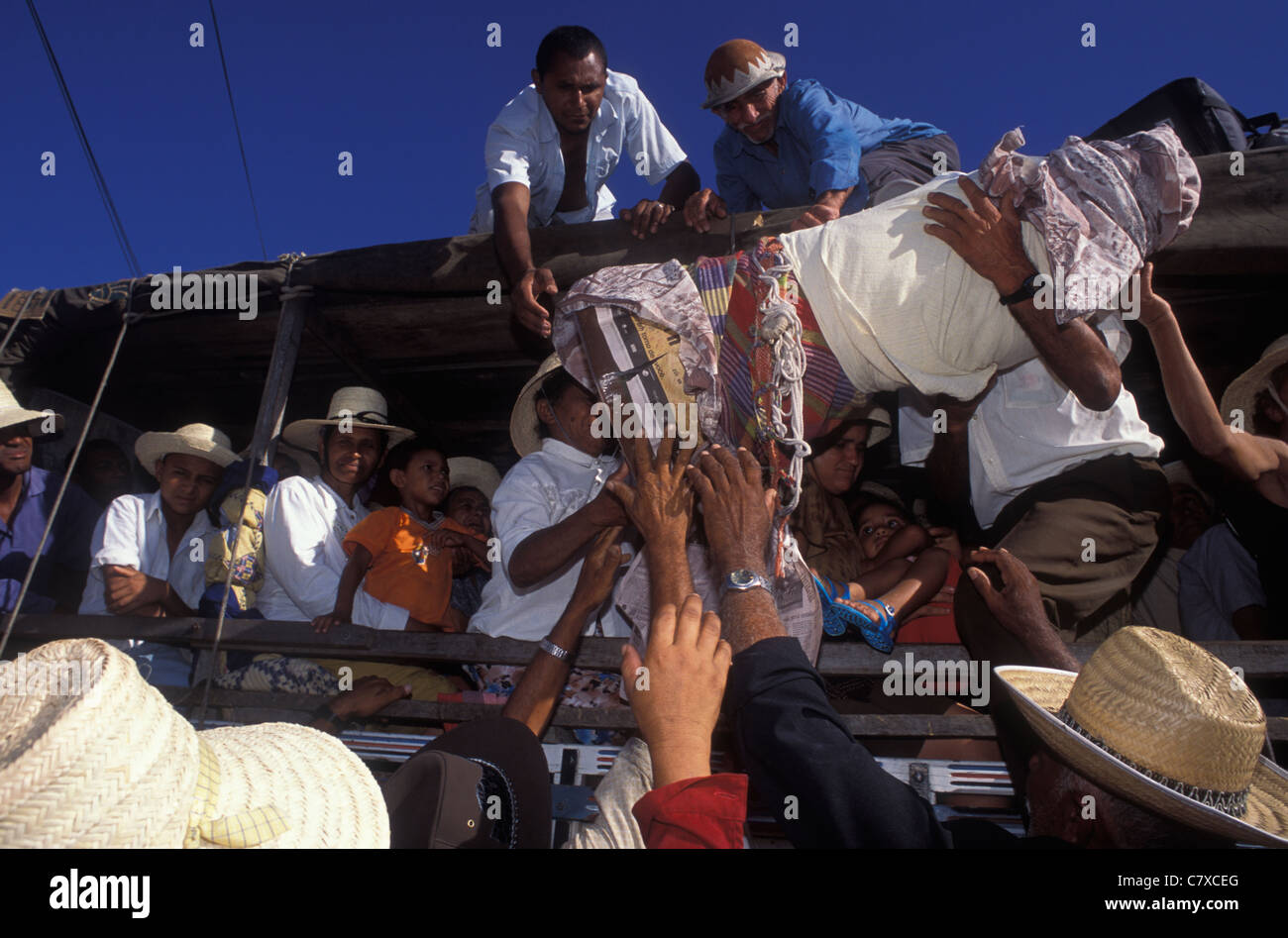 Catholicism, pilgrimage to Juazeiro do Norte city in Ceara State, Brazil. Pilgrims transport religious image Stock Photo
