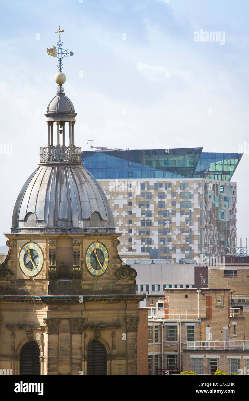 St. Philips cathedral in Birmingham. England, along with The Cube building in the rear. - Stock Image